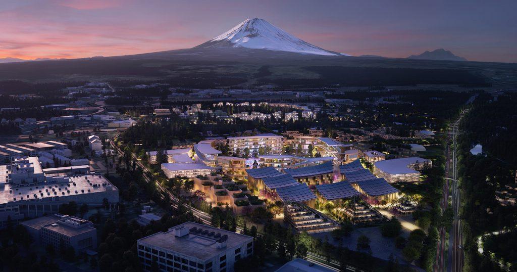 Woven City de Toyota vista desde el aire en la noche